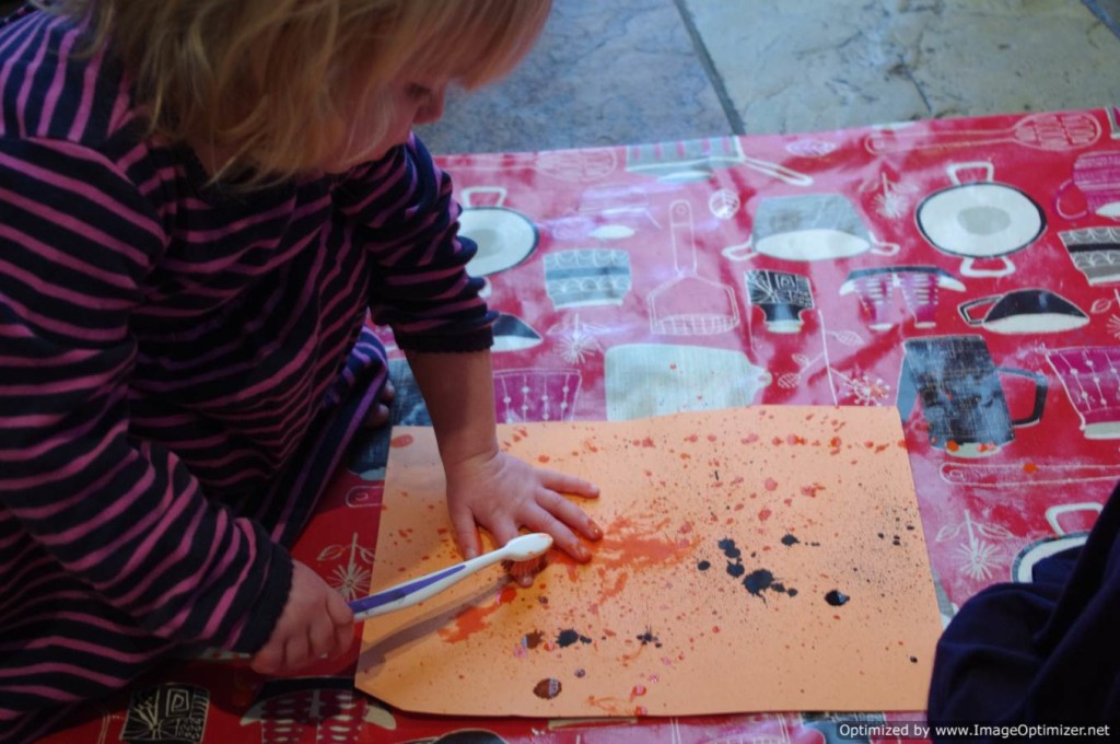 painting with a toothbrush
