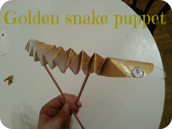 gold snake puppet for Chinese New Year