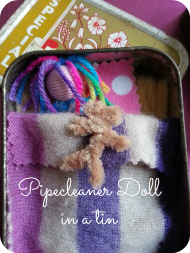 pipecleaner doll in a tin